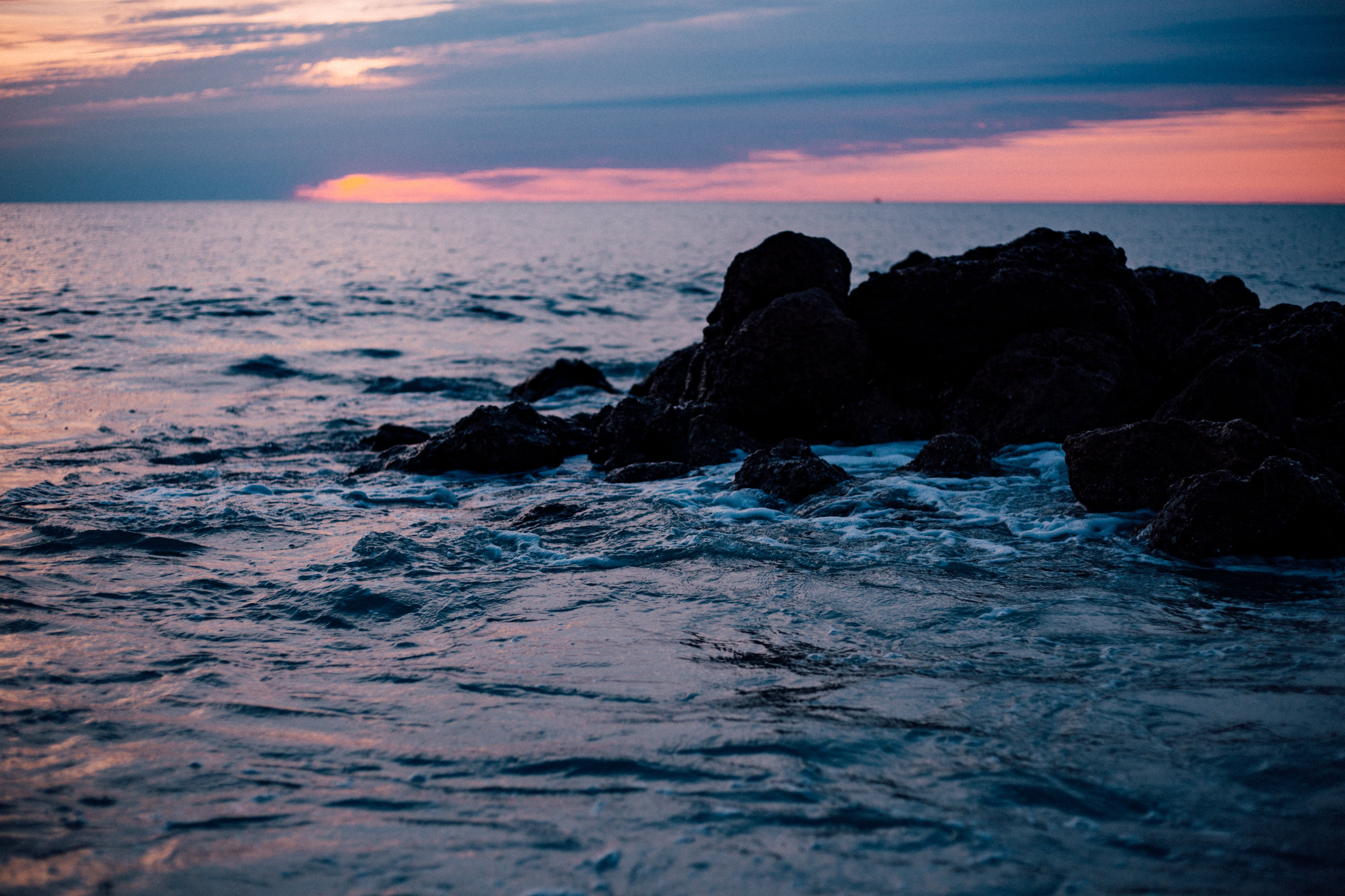 Rocky Sea Shore during Sun Set