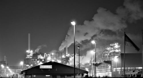 Grayscale Photography of a Factory