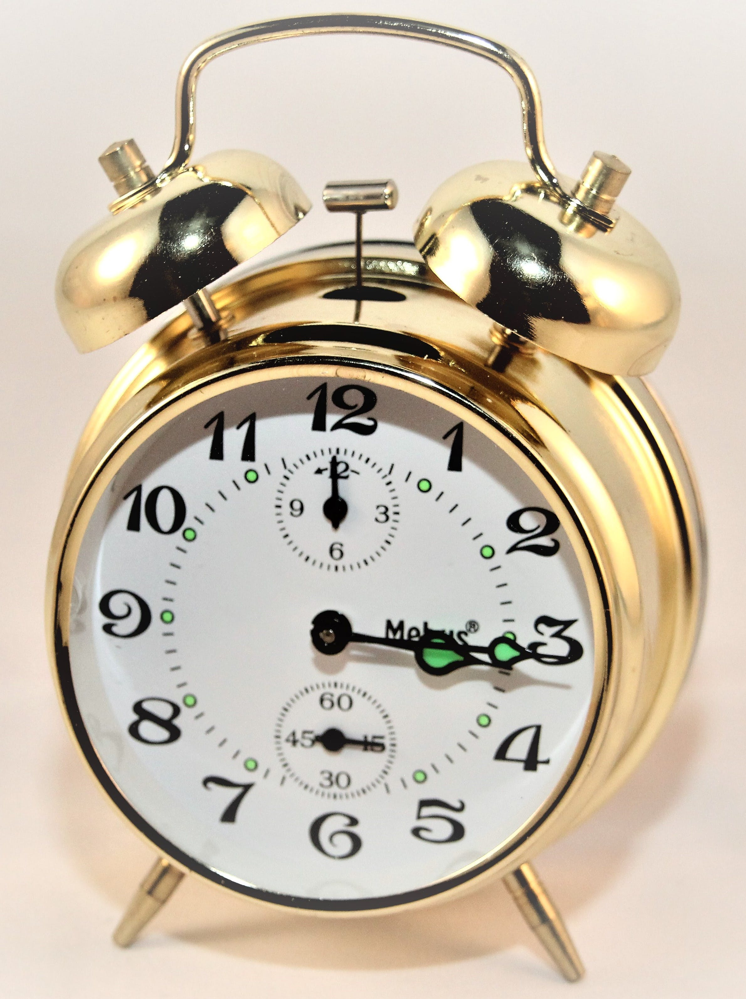 Brass-colored Alarm Clock at 3:15