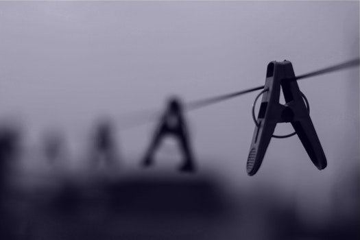Gray Scale Image of Clothes Pin on Clothe's Line