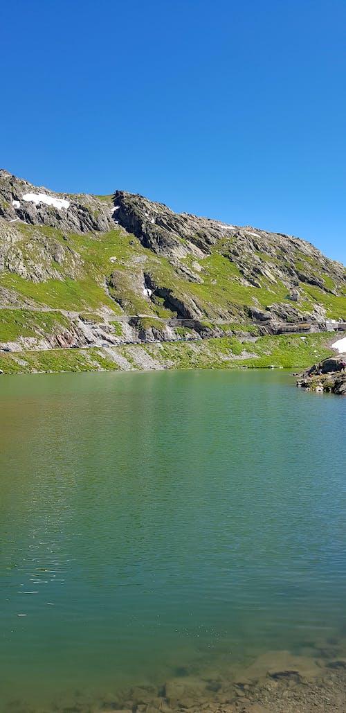 Free stock photo of lake, mountains, shades of green