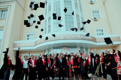 Free stock photo of graduation cap throwing, graduation ceremnoy, students graduation