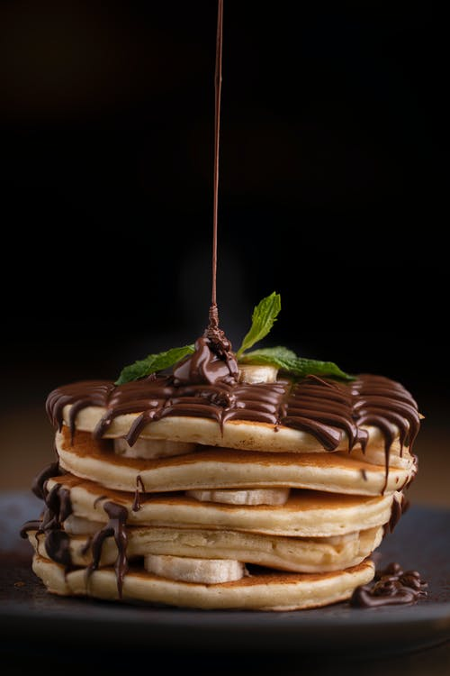 Close-Up Shot of Delicious Stack of Pancakes with Chocolate
