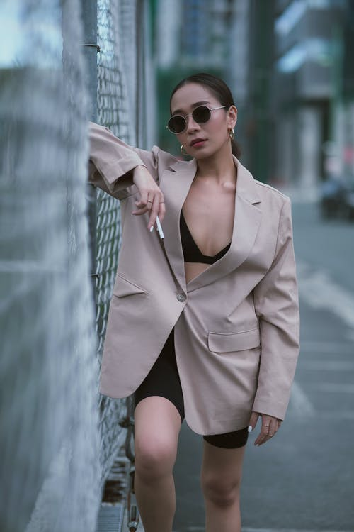 Woman in Brown Coat Wearing Sunglasses
