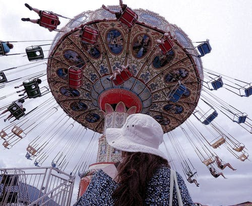 Free stock photo of amusement rides, flying swings