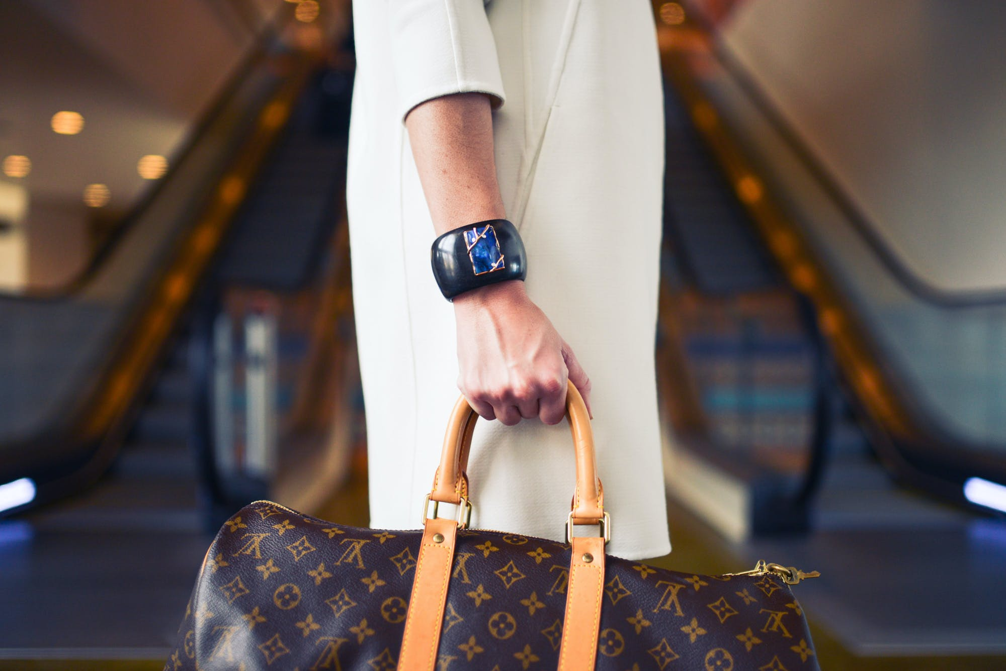 Person Carrying Monogrammed Louis Vuitton Handba