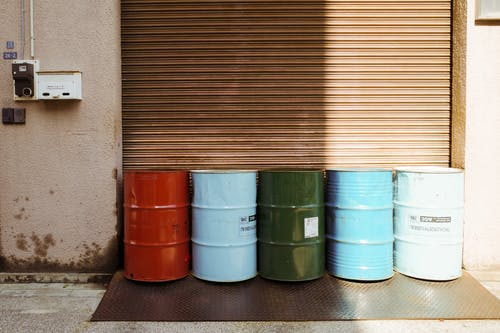 Green and Gray Steel Barrels