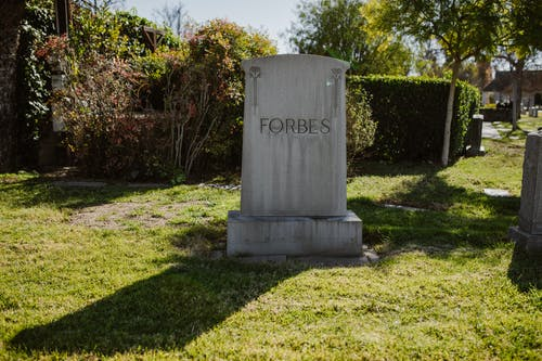 Gray Concrete Tomb on Green Grass Field