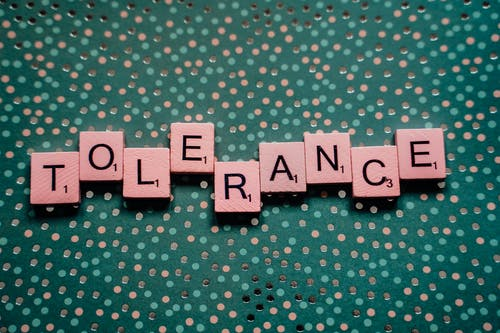 Scrabble Tiles Spelling Out the Word Tolerance
