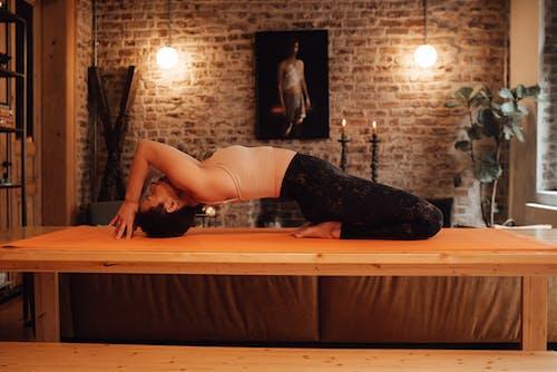 Slim woman doing yoga in Upward Bow pose