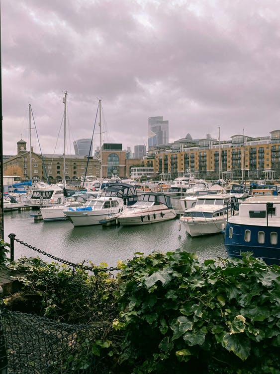 Yachts moored on river shore in port