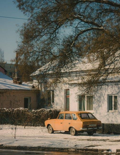 Retro car parked near countryside house