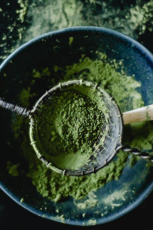 Green Powder in Blue Ceramic Bowl