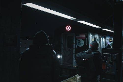 People standing on platform of subway