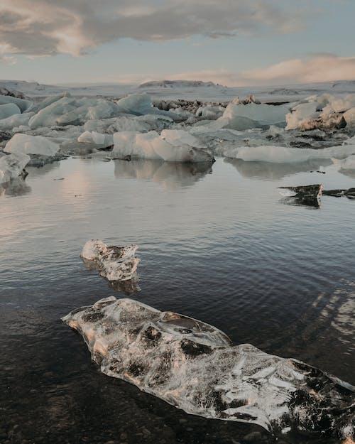 Ice pieces near calm river
