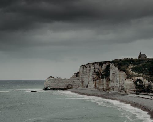 Rocky formations near rippling sea