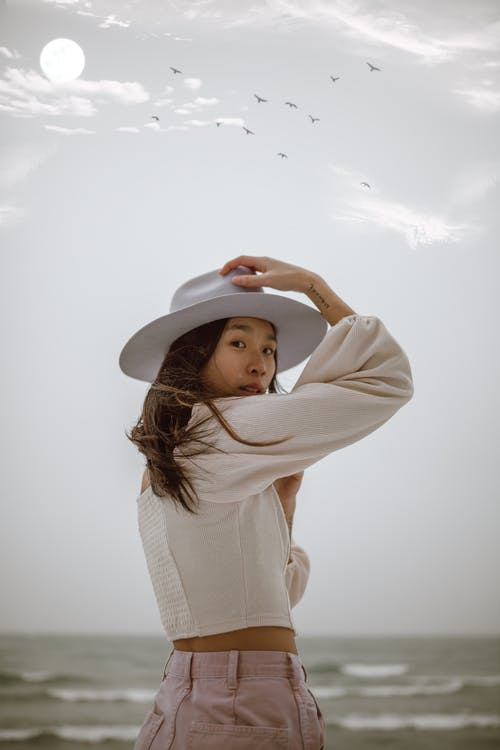 Woman in White Long Sleeve Shirt and White Hat