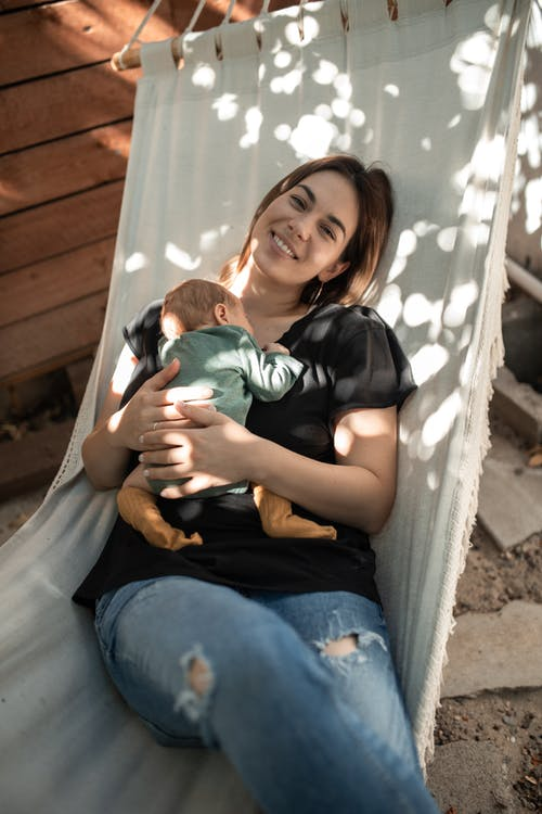 A Woman on a Hammock with Her Baby