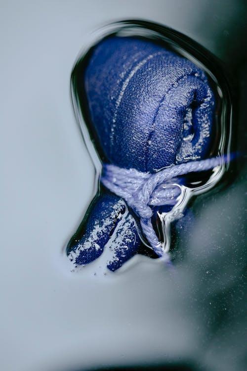 Tied blue fabric in dye