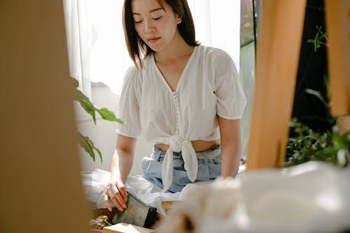 Crop ethnic artisan with shibori set at home