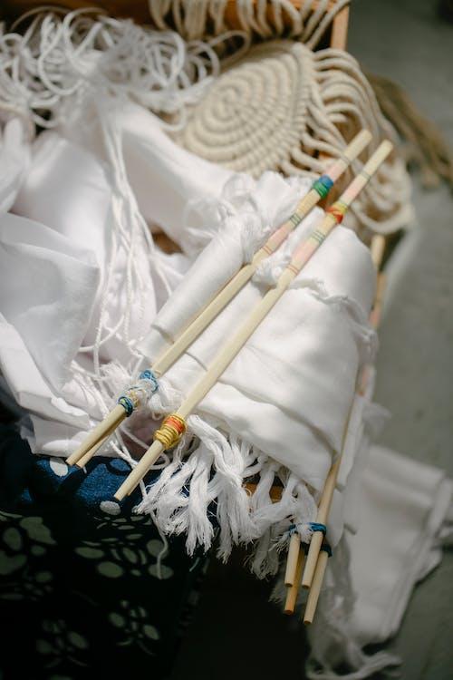 Poles on folded textile for tie dye in sunlight