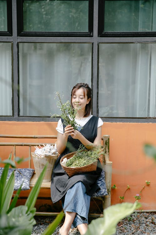 Young woman with plant in hands