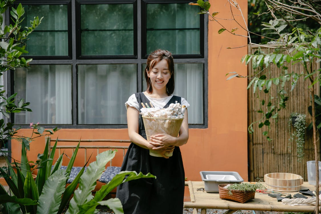 Young Asian woman with wicker basket