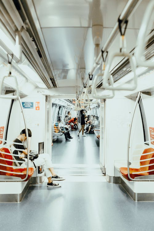 Anonymous people commuting by modern train