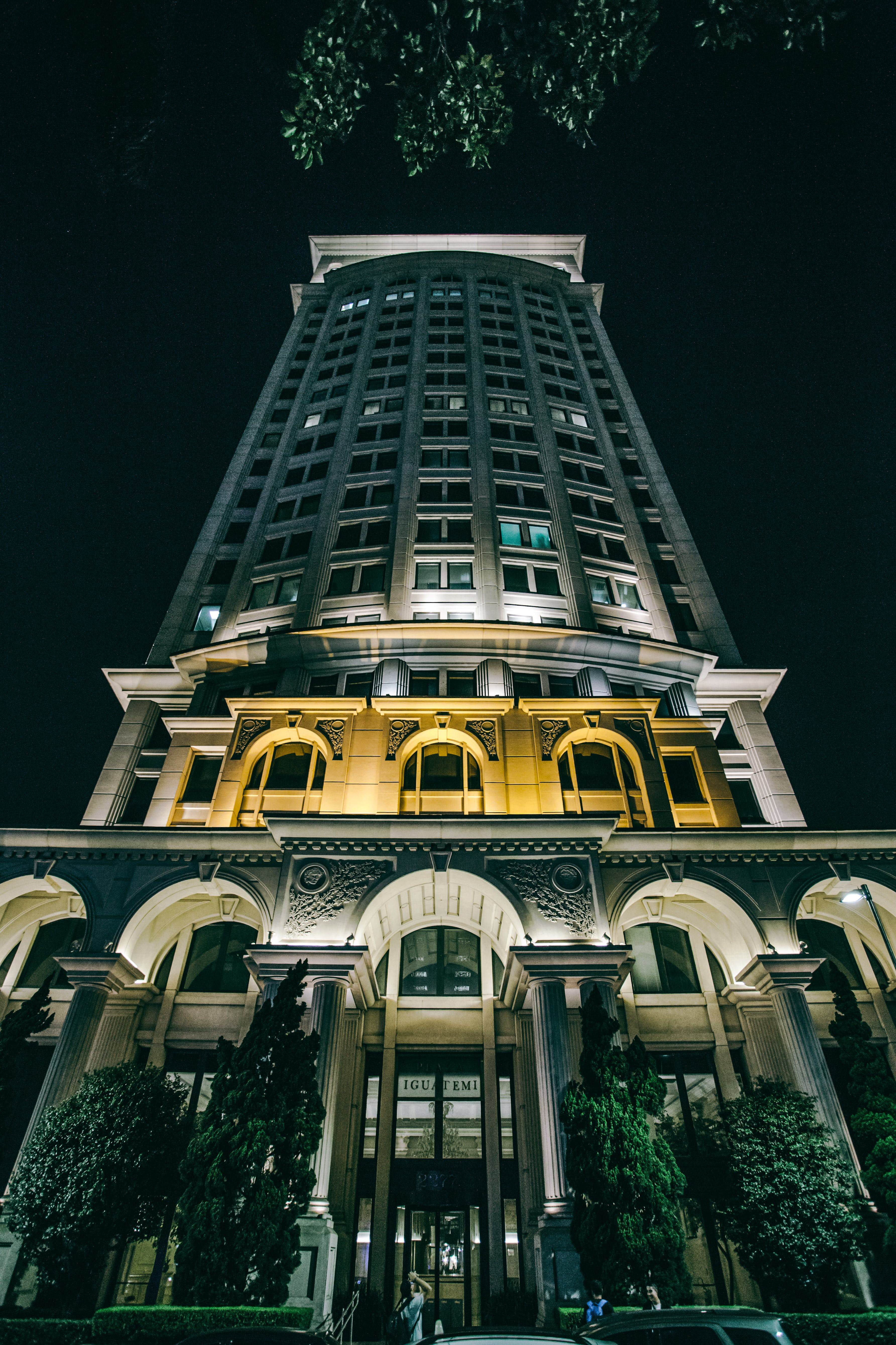 Low Angle Photography of High-rise Building at Night