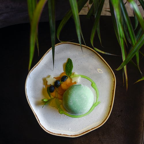 Green and Yellow Fruit on White Ceramic Plate