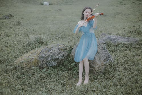Woman in Blue Dress Playing Violin