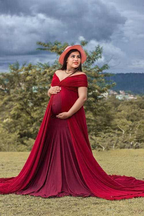 A Pregnant Woman in a Red Dress