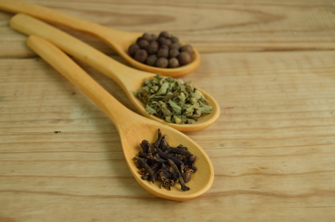 Vegetables and Beans on Brown Wooden Measuring Spoon
