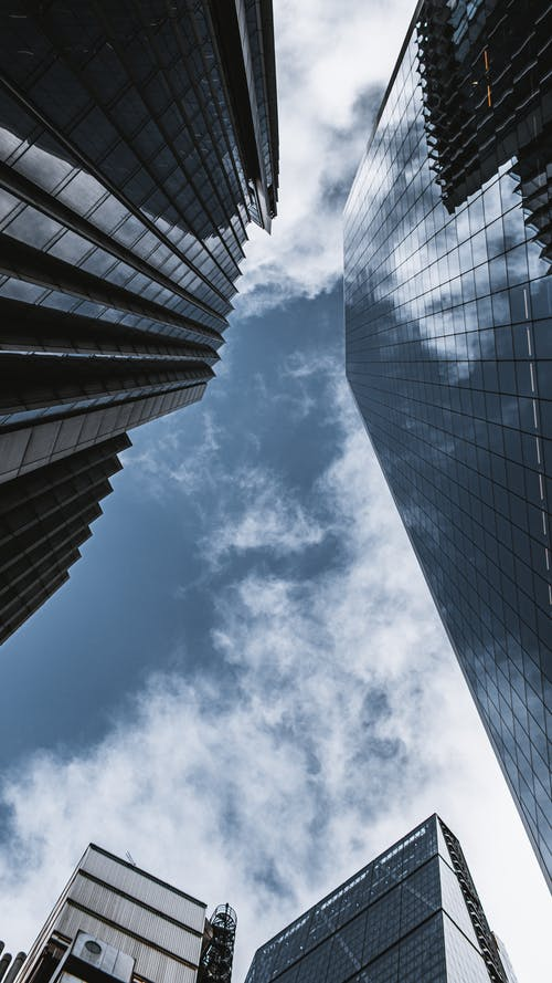 Low Angle Photography of High Rise Building Under Blue Sky