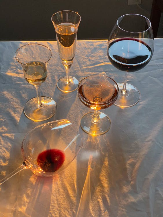 Glasses with alcoholic drinks placed on table