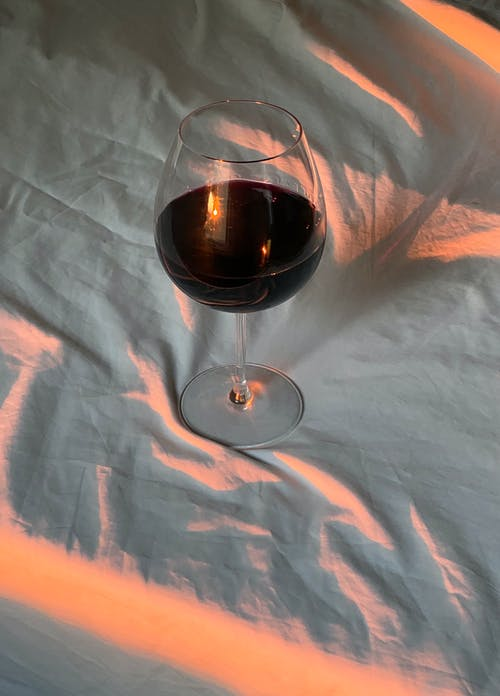 Clear Wine Glass on White Textile
