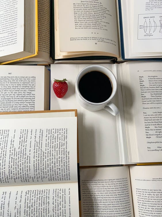 Coffee Drink Placed on Top of Open Book