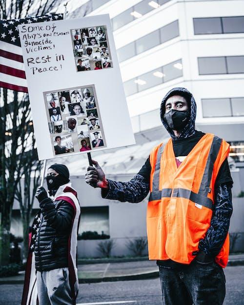 Photos gratuites de activiste, aide, avertissement