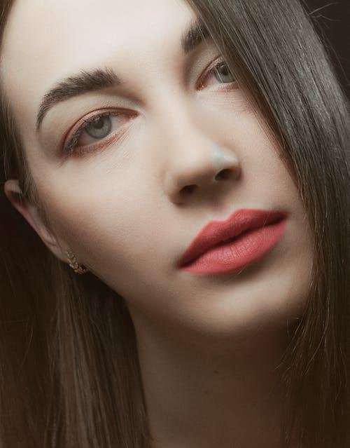 Close-Up Shot of a Beautiful Woman Looking at Camera