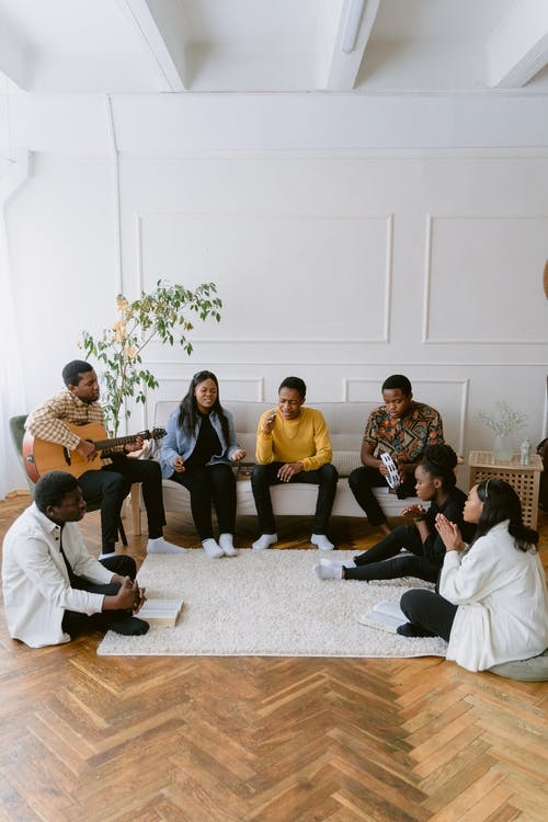 A Group of People Singing in a Room
