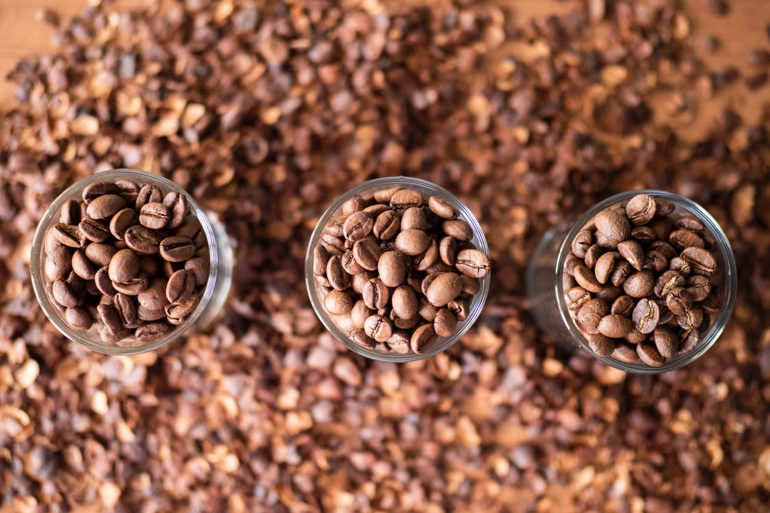Close-Up Shot of Coffee Beans on Containers