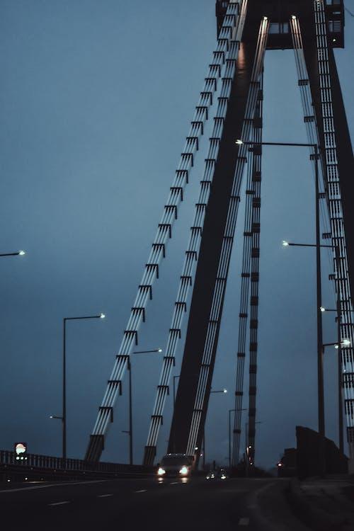 Cars driving on bridge in twilight