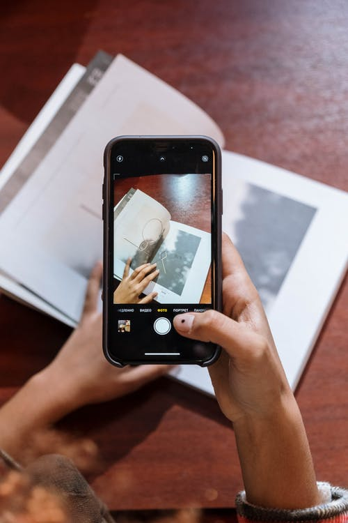 Close-Up Shot of a Person Taking Photo Using a Mobile Phone