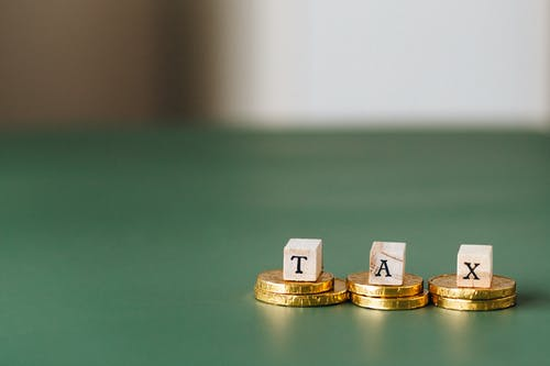 Tax Word on Top of Gold Coins