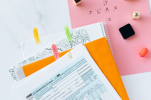 Tax Return Form and Notebooks on the Table