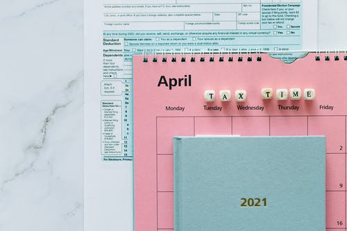 Tax Return Form and 2021 Planner on the Table