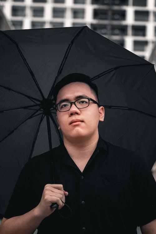 Man in Black Button Up Shirt Wearing Black Frame Eyeglasses