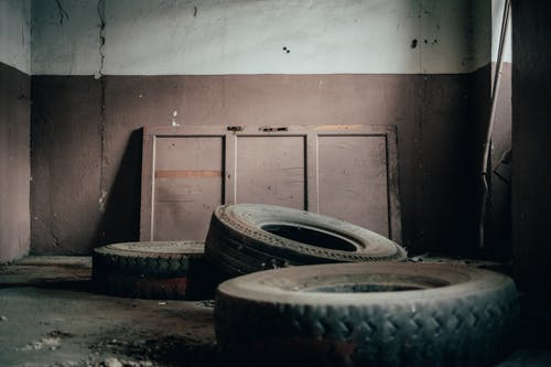 Abandoned tires in dirty room