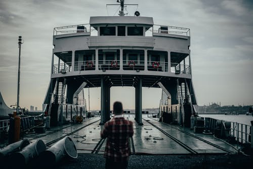 Anonymous man standing on ferry