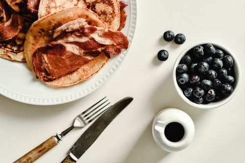 A Plate of Pancakes and a Cup of Blueberries